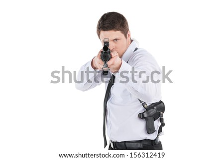 Bodyguard. Confident young man in shirt and tie holding gun and aiming while standing isolated on white - stock photo