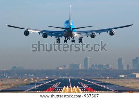 Boeing 747 about to touchdown at Amsterdam Schiphol airport.