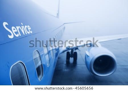 boeing airplaine exterior close up, fog - stock photo