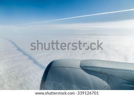 Boeing airplane flies over clouds at the height of 10000 meters - stock photo