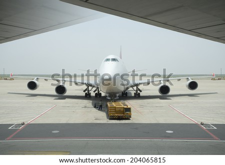 Boeing 747 airplane under maintainance at shanghai airport - stock photo
