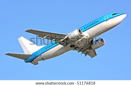 Boeing 737 in blue sky - stock photo