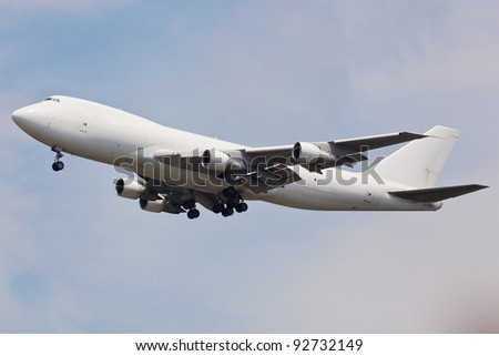 Boeing 747 in full landing configuration - stock photo