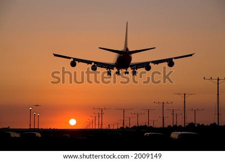 Boeing 747 / Jumbo Jet coming in for a landing at LAX during sunset - stock photo