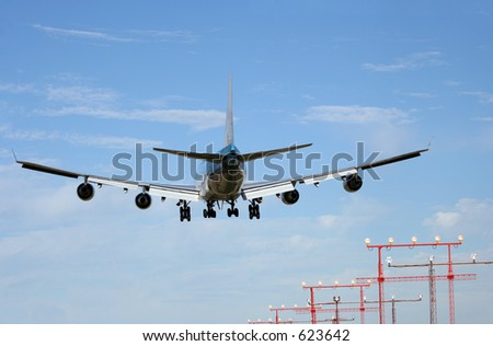 Boeing 747 over approach lights - stock photo