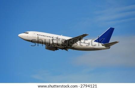 Boeing 737 passenger jet in flight - stock photo