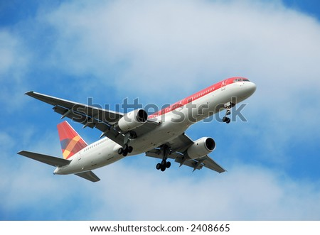 Boeing 767 passenger jet on approach to landing - stock photo