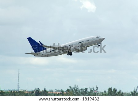 Boeing 737 passenger jet taking off - stock photo