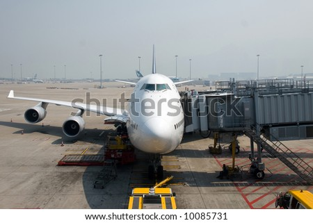 Boeing 747 waiting at the gate for take off. - stock photo