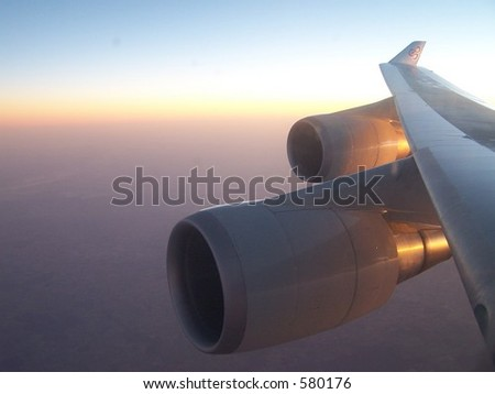 Boeing 747 wing at sunset - stock photo