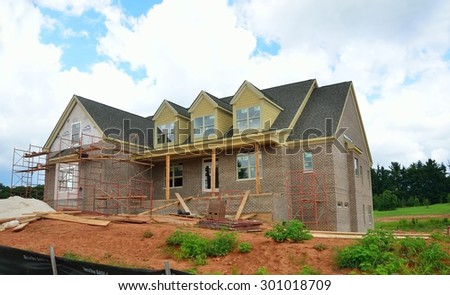 BOGART, GEORGIA, USA - JULY 24, 2015: Home construction is picking up at local counties in Georgia. Shown is a home being constructed at development in Bogart, Georgia. - stock photo