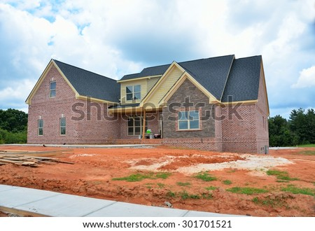 BOGART, GEORGIA, USA - JULY 24, 2015: Home construction is picking up at local counties in Georgia. Shown is a upscale home being constructed at development in Bogart, Georgia. - stock photo