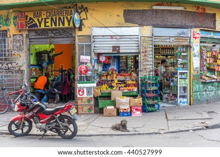 BOGOTA, COLOMBIA - APRIL 23: Street corner in Bogota, Colombia with a bar on one side and a market on the other on April 23, 2016 - stock photo