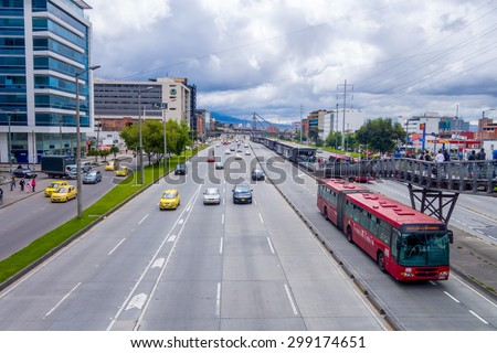 BOGOTA, COLOMBIA - FEBRUARY 9, 2015: Great overview shot of main road portraing red public transportation Transmilenio, background brick urban buildings from Bogota Colombia - stock photo