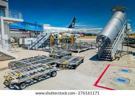 BOGOTA, COLOMBIA - MARCH 07, 2015: Avianca ground support equipment dollies and stairs at international airport el Dorado in Bogota  - stock photo