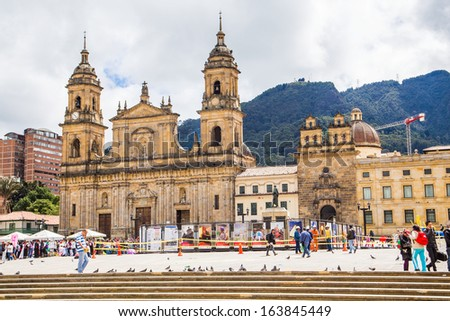 BOGOTA, COLOMBIA - NOV 18: Bolivar Simon Square and the Cathedral on November 18, 2013 in Bogota, Colombia. The Cathedral is located in the famous and historical area called Candelaria. - stock photo
