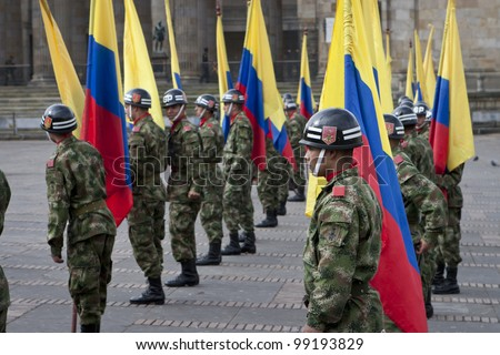 BOGOTA, COLUMBIA - JANUARY 18: Colombian soldiers march and perform during a military parade at Historical Central, Plaza de Bolivar on January 18, 2009 in Bogota, Colombia. - stock photo