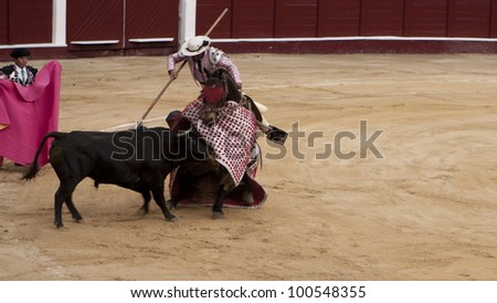 BOGOTA - JANUARY 18: An unidentified Colombian Javelin performs in the Plaza de Toros on January 18, 2009 in Bogota, Colombia.The popular bullfighting competition is held annually in Plaza de Toros. - stock photo