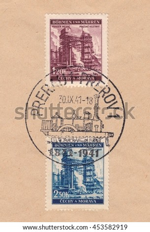 BOHEMIA and MORAVIA-CIRCA 1941:A stamp printed in Czechia,shows Industrialization,Prague fair.Postmark of the city of Prerov steam locomotive,circa 1941. - stock photo