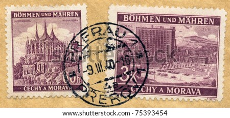 BOHEMIA - CIRCA 1939: A two stamps printed during german occupation of Czechoslovakia, shows St. Barbara's Church, Kutna Hora and Zlin, circa 1940