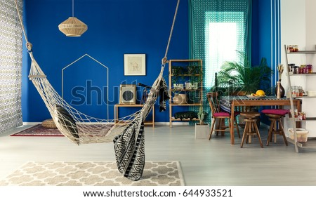 Bohemian Apartment With Blue Wall Hammock Pattern Rug Dining Table