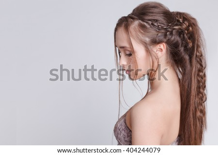 Bohemian style. Women Hairstyle with braid , romantic. Grey background. Copytext - stock photo