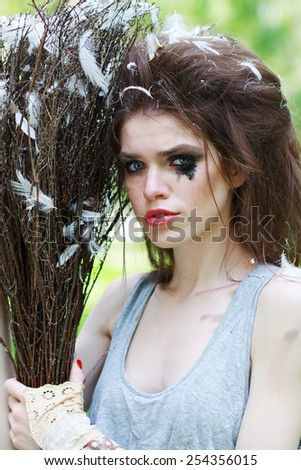 Boho fashion style crying Sindirella sweeping ourdoor - stock photo