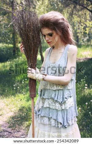 Boho fashion style Sindirella sweeping ourdoor - stock photo