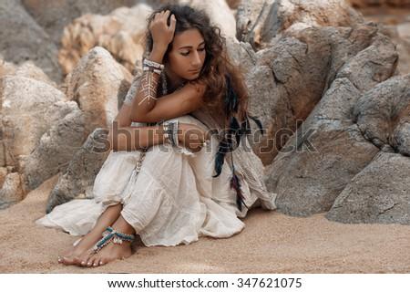 Boho model on beach - stock photo