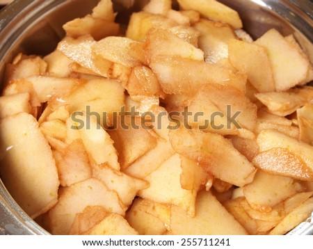 Boil apples in pan. Making Apple Pie Tart  Series. - stock photo