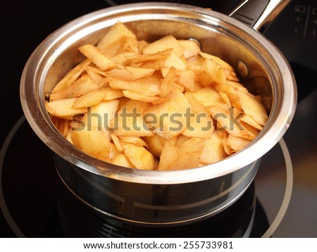 Boil apples in pan. Making Apple Pie Tart  Series. - stock photo