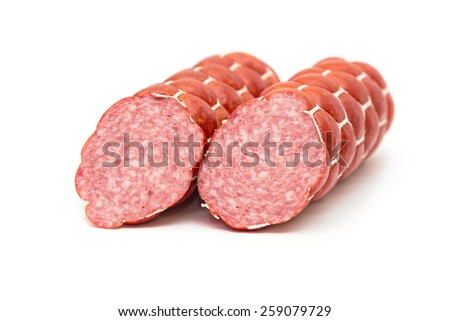 Boiled and smoked sausage cut into two pieces on white background - stock photo