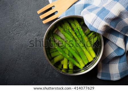 Boiled asparagus on a dark  background  - stock photo