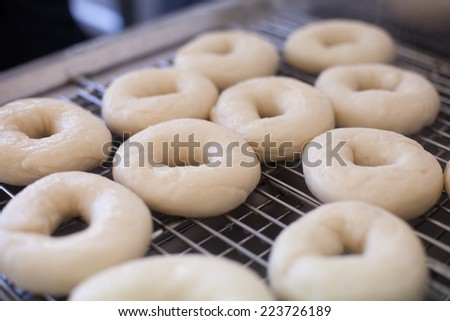 Boiled bagel bread on tray - stock photo