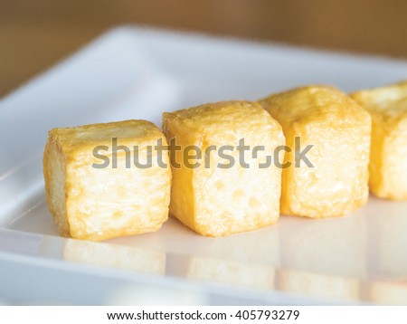 boiled bean curd in cubic shape ready to serve on white dish - stock photo