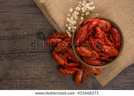 boiled big crawfish on the wooden surface
