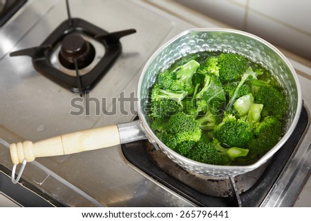 Boiled broccoli on the pan - stock photo