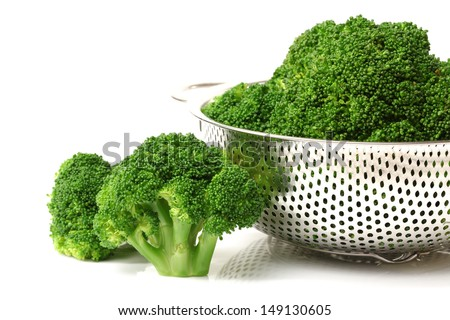 Boiled Broccoli ready for green salad on white background - stock photo