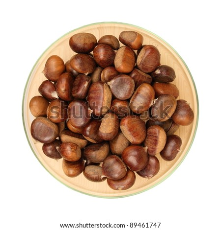 boiled chestnuts in a glass plate, isolation, white background - stock photo