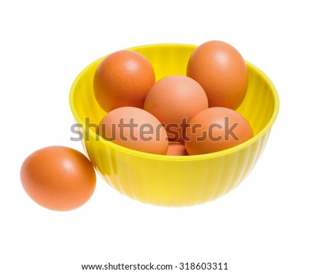 Boiled chicken eggs in a plastic bowl
