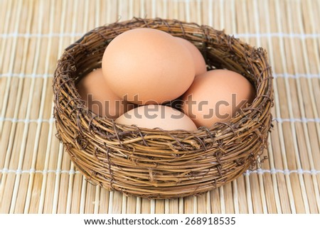 Boiled chicken eggs lying in a basket - stock photo