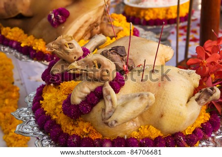 Boiled chicken, food for pay respect to god. - stock photo
