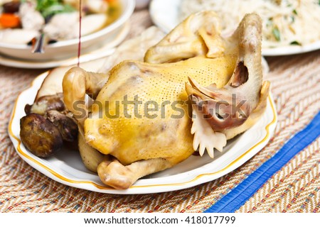 Boiled chicken on dish for Chinese New Year Festival - stock photo