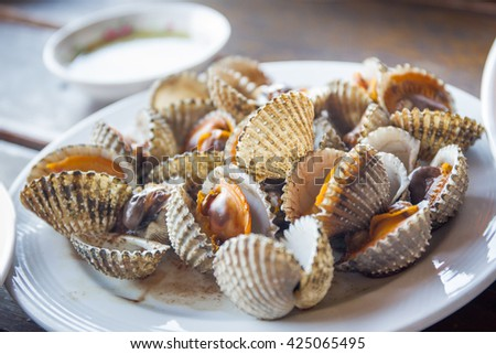 Boiled Cockles with spicy Thai seafood sauce. - stock photo