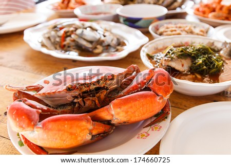 Boiled crab prepared on plate on table set - stock photo