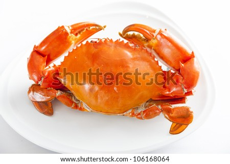 Boiled crabs prepared on plate.