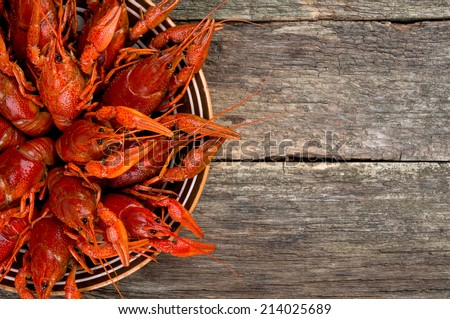 boiled crawfish on wooden surface - stock photo