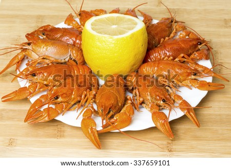 Boiled Crayfish on the Plate with Lemon - stock photo