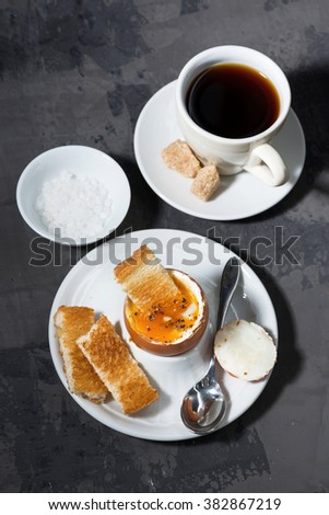 boiled egg, cup of coffee and crispy bread, vertical, top view, closeup