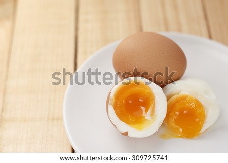 boiled egg. medium-boiled egg. half-boiled egg. boiled egg on white dish. cooked egg.  - stock photo